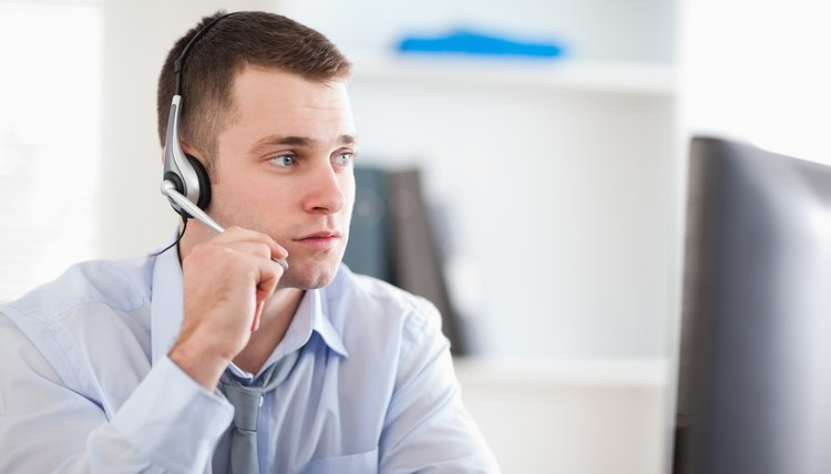 Call center agent speaking with costumer