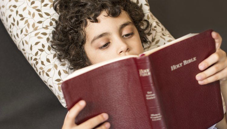 Child reading from the Bible