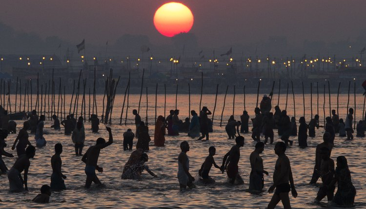 Hindu devotees bathe during what is believed to be the world's largest religious gathering.