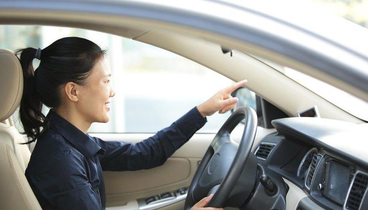 Asian Businesswoman Driving A Car