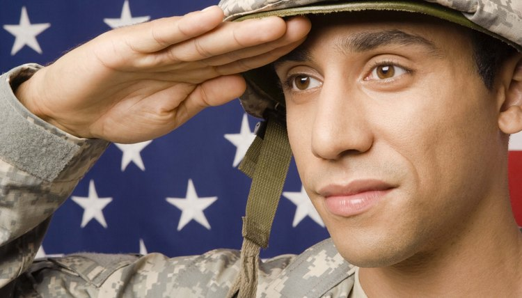 pay grades in the army wth a high school diploma vs ged career   ier saluting by american flag