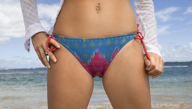 Waist of woman wearing a bikini