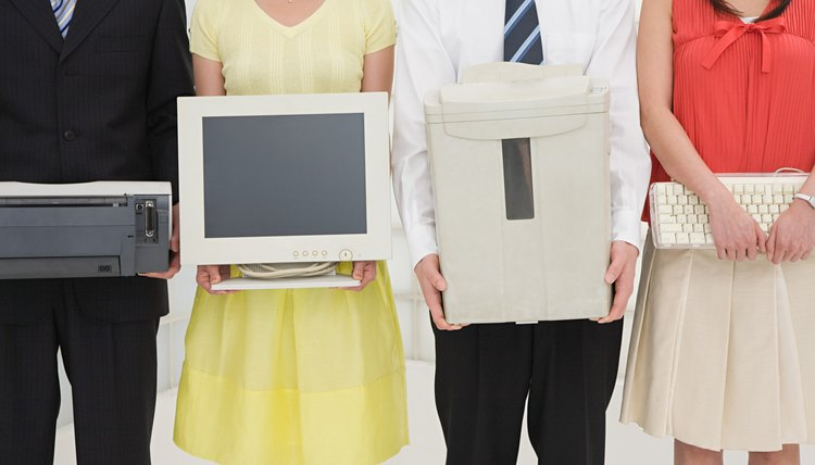 People holding office equipment