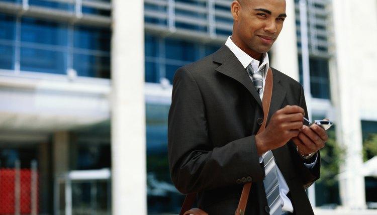 Business man wearing leather shoulder bag.