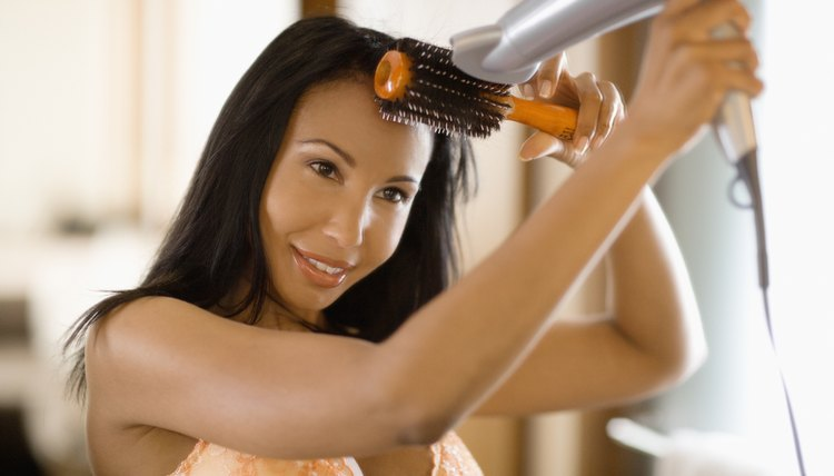 Boost volume by brushing hair upwards as you blow dry.