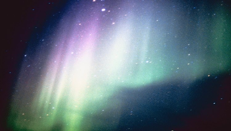 Auroras are caused by sunspots, which release plasma that collides with the atmosphere.