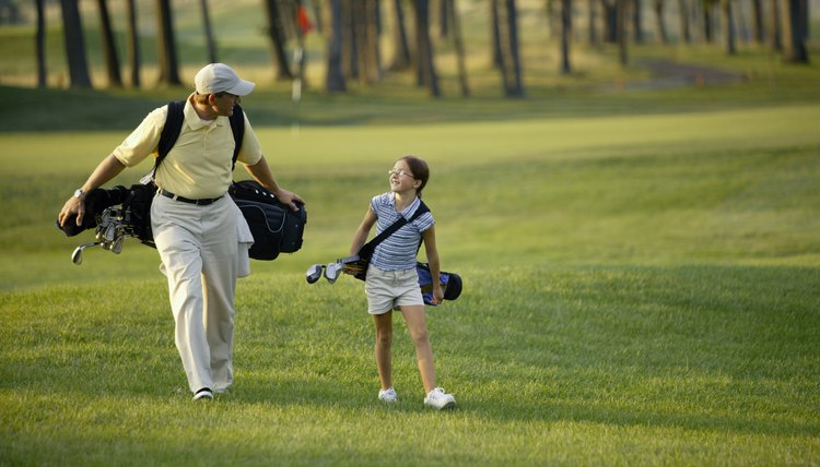 A golf outing forms a special bond between child and parent.