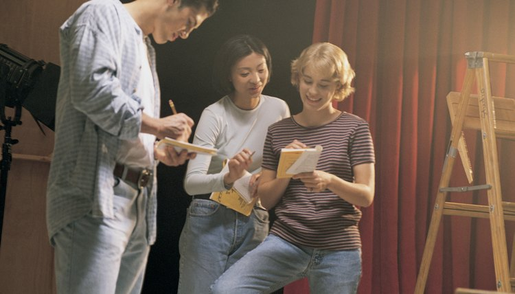Teenage actors rehearsing play