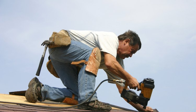 roofer - man repairing roof