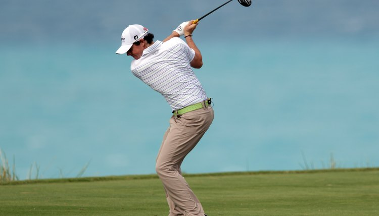 Northern Ireland's Rory McIlroy makes a strong move on the left side of his body to generate a more powerful golf swing.