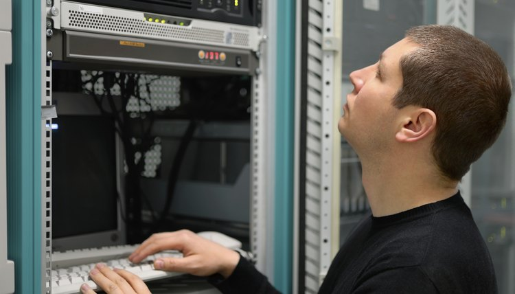 Network technician performs preventive maintenance a server