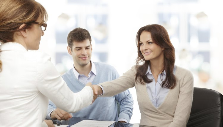 financial advisor and client handshaking