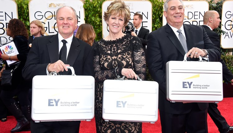 Ernst & Young representatives bring in the list of winners to the Golden Globes awards show.
