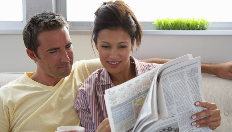 Couple reading the newspaper.