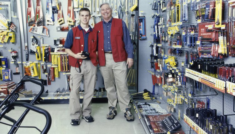 Portrait of two male clerks in a hardware store