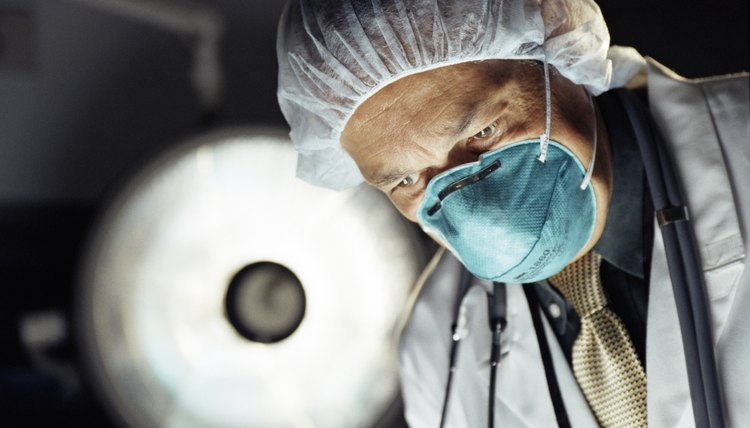 surgeon looking down - Orthopedic Doctor Job Description