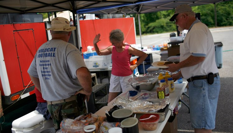 Members of a Moose lodge hosting a bbq for a charity event.