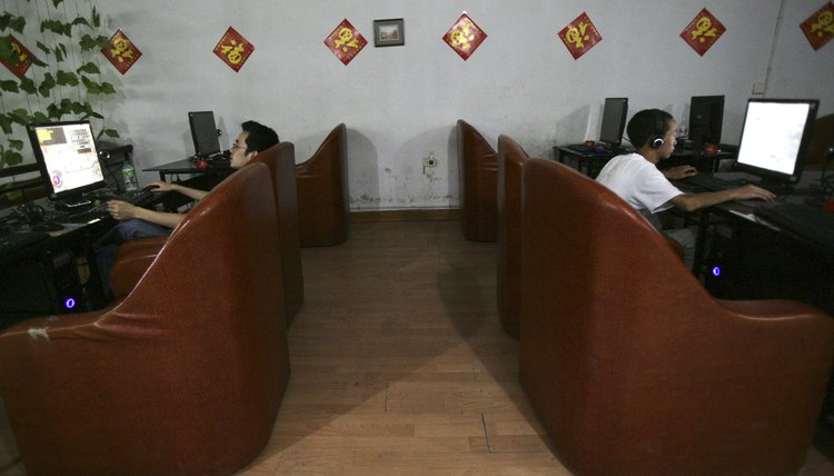 People surf the web at an Internet cafe in China