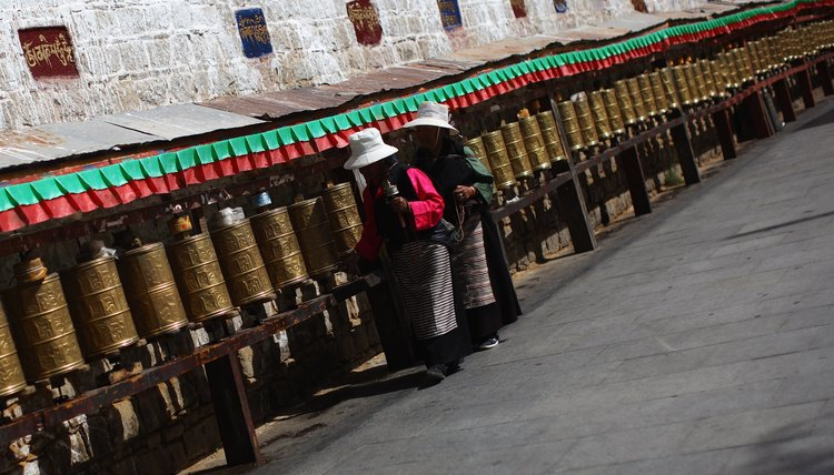 Turning an engraved prayer wheel earns merit for all sentient beings.