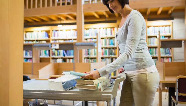 Librarian pushing book cart