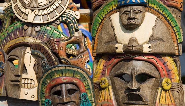 Mexican masks are displayed outdoors.