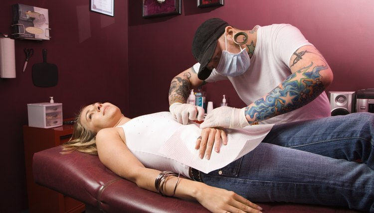 Woman getting pierced.