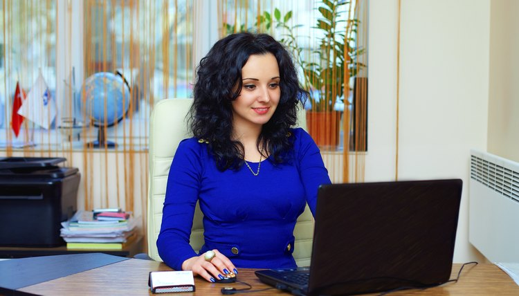 young business woman concentrated on work in office