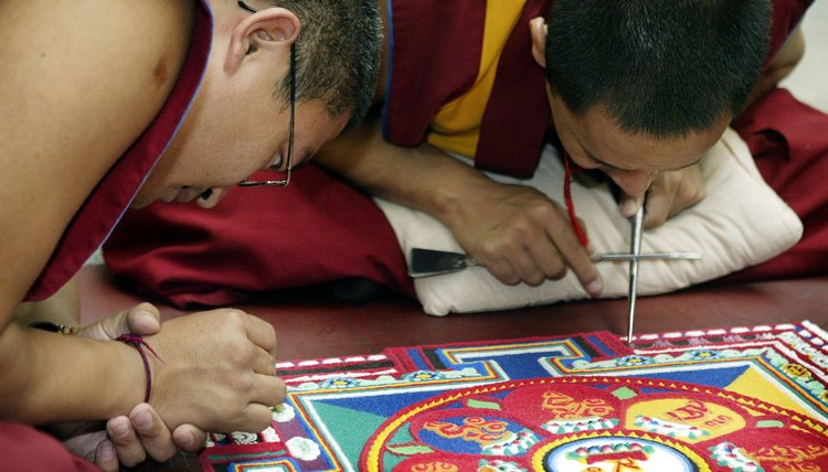 Buddhist monks making a sand mandala.