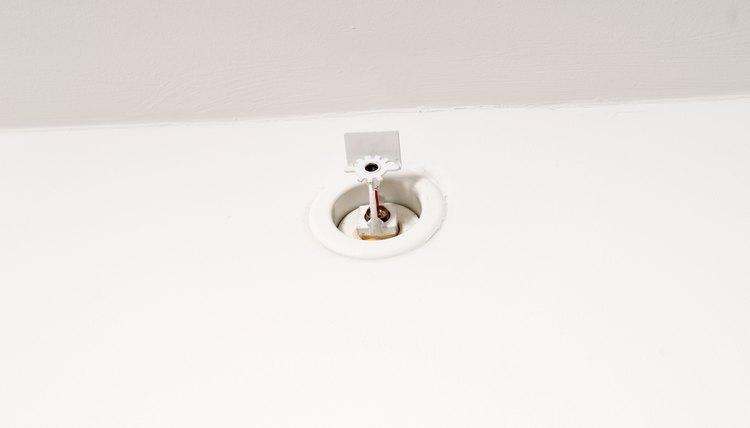 Sprinkler on wall near ceiling