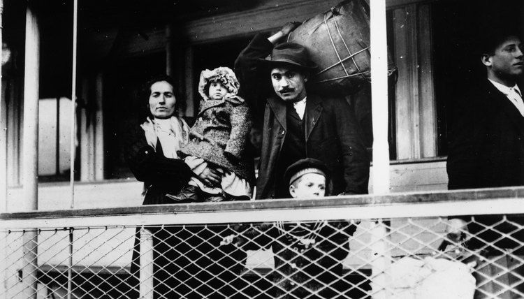 Early 20th century Italian immigrant family on ferry docking at Ellis Island, New York