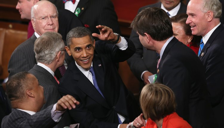 President Obama is seen here greeting members of Congress after a State of the Union speech.
