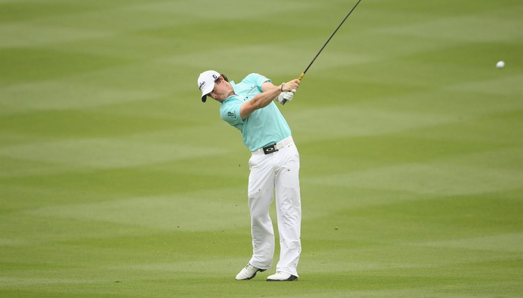 At shoulder height on the finish, McIlroy's wrists are re-cocking and his chest faces the target.