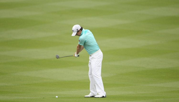 With his hands at waist high, both of McIlroy's elbows are still extended and his wrists haven't begun to set.