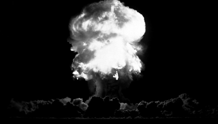 In an atom bomb, uncontrolled nuclear reactions produce large amounts of energy.