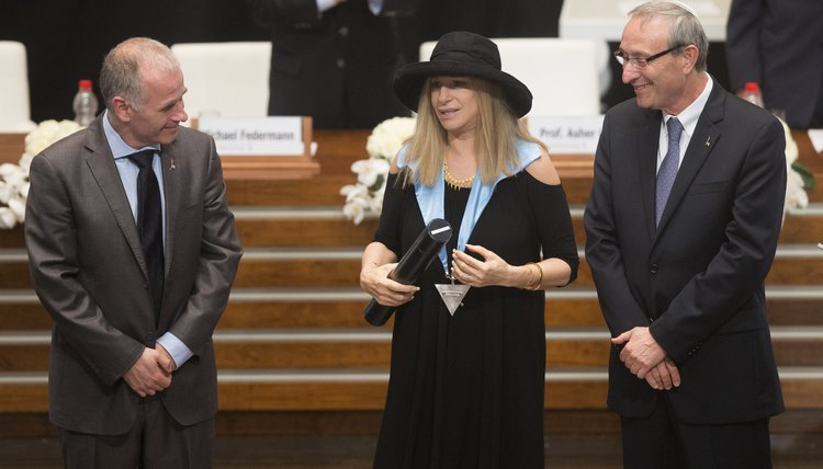 Universities sometimes confer honorary doctorates on celebrities, such as Barbra Streisand.