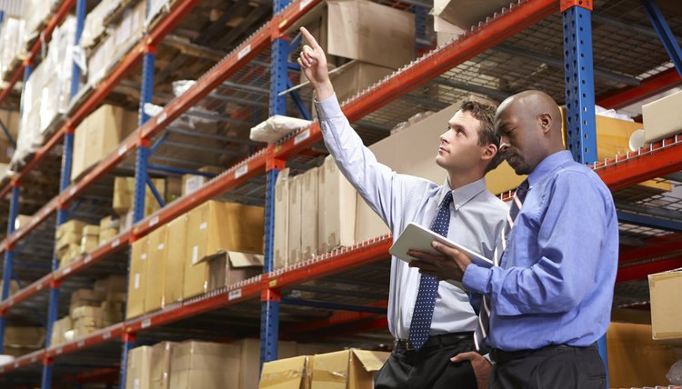 Two Businessmen In Warehouse