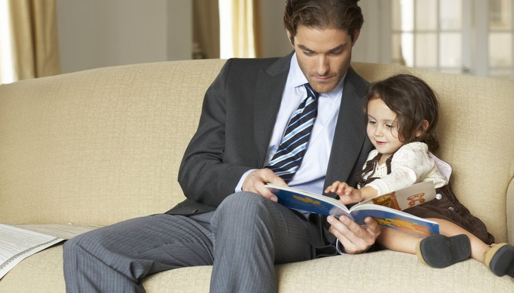 Parent reading with young child on couch