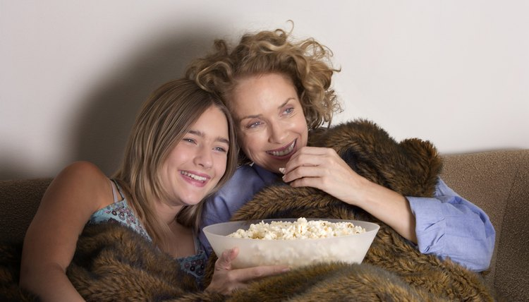 Rent a funny movie and laugh the night away with your mom.
