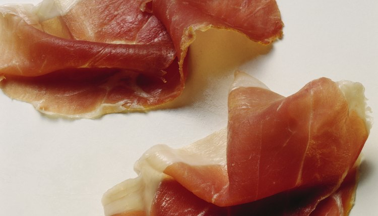 Prosciutto is usually served thinly sliced in antipasti.
