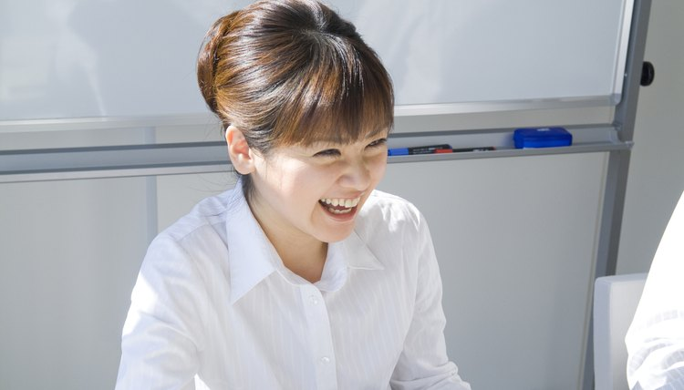 Businesswoman smiling during a meeting
