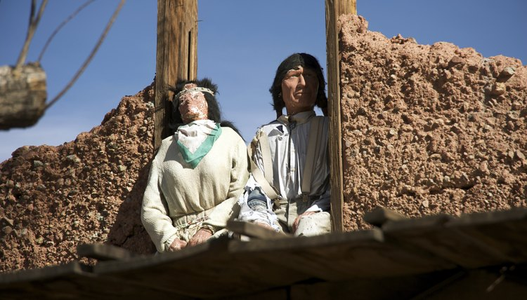 Indian dolls on top of old mining town building in California
