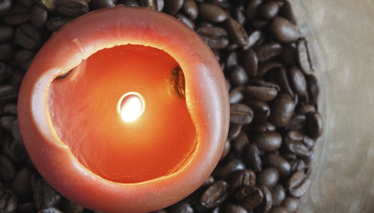 A candle burning in coffee beans.