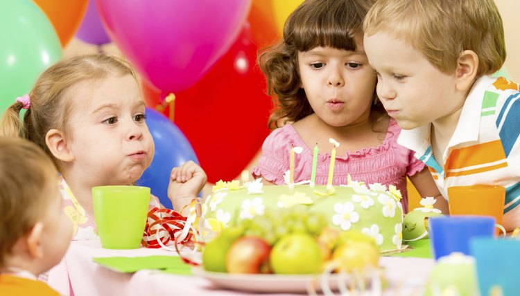 Children blowing out candles