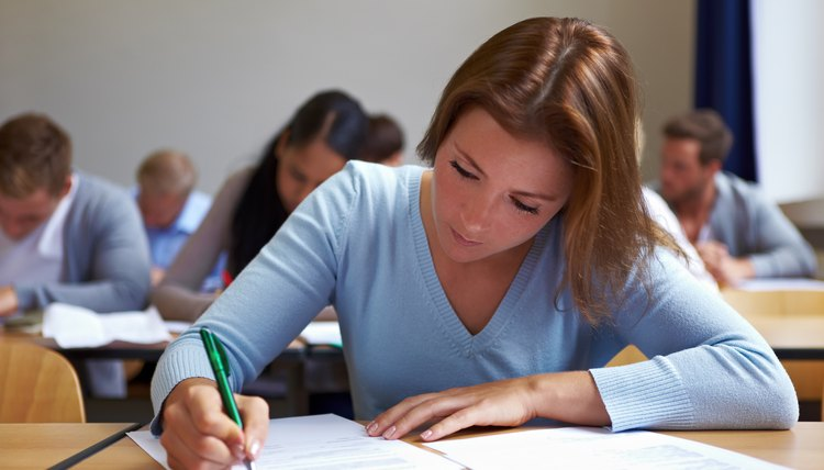 A student taking the ACT in a classroom.