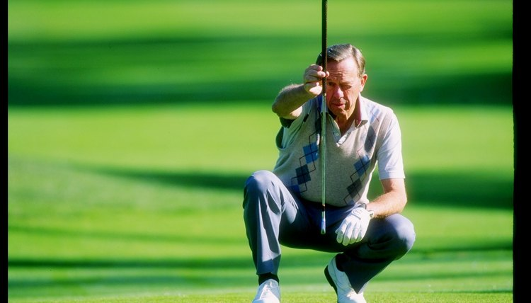 An Earth-bound Alan Shepard prepares to putt in 1995.