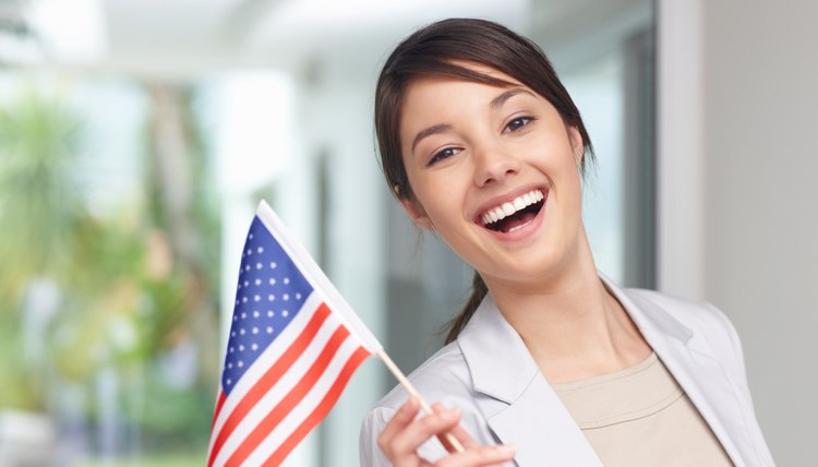 Happy young woman holding an American flag