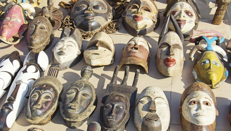 Assortment of African masks on ground.