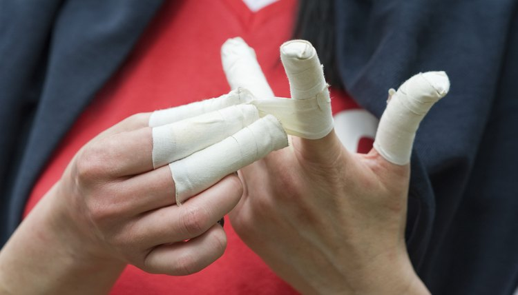 Why Do Football Players Put Tape Around Their Fingers?