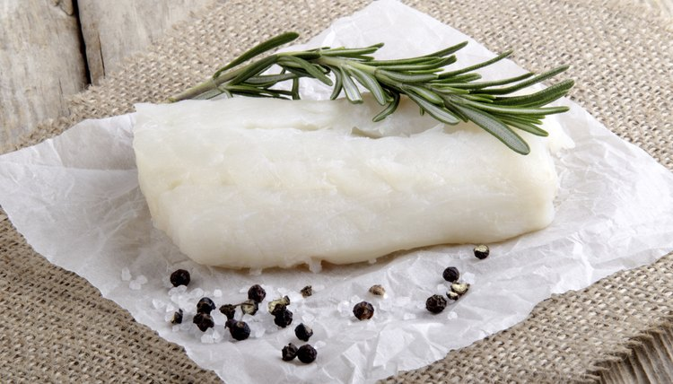 Fresh cod with salt, pepper and rosemary.