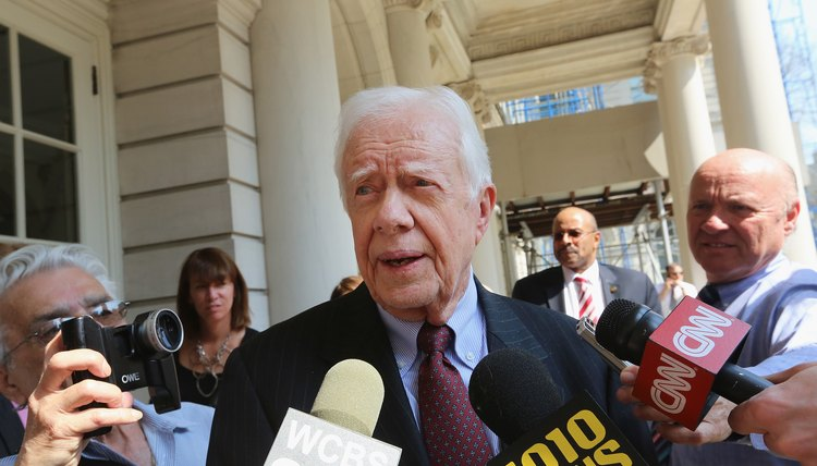 Jimmy Carter speaks to the media.